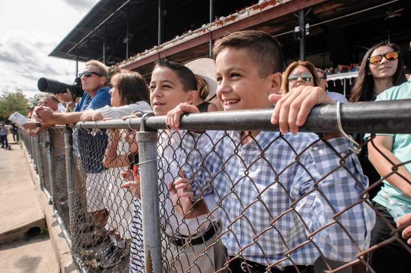 Jake and Luke Vazquez cheer for their favorite during the Ketel One Ballerina at the Saratoga Racecourse on Aug. 26.