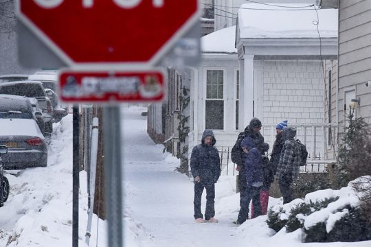 Residents stand outside of the Code Blue Saratoga shelter, Jan. 8, 2018.