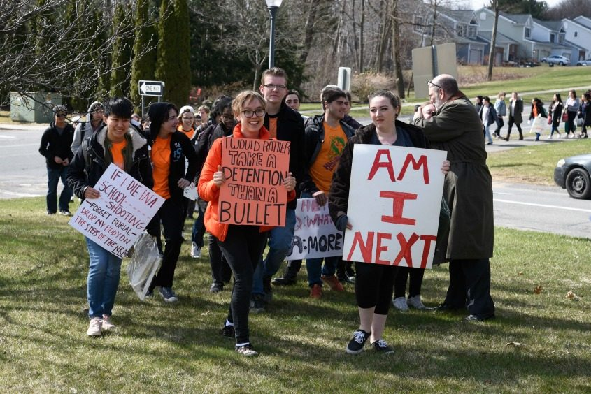 Students walk to Niskayuna Town Hall on Friday to rally for gun control legislation.