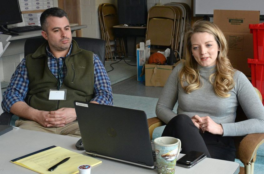 Micah Ilowit and Anna Brady discuss their jobs in the William C Keane Elementary School Annex building on Albany Street.