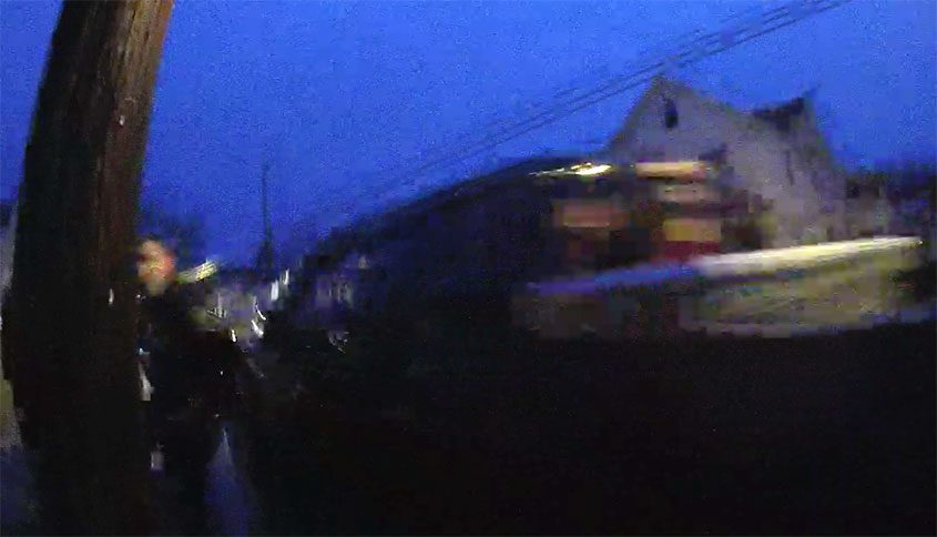 A still from video showing a Gloversville officer being hit by a pick-up truck, April 25, 2018.