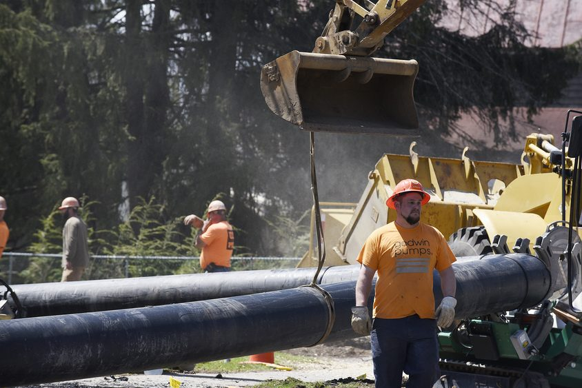 Construction workers with Tom Kubricky Company perform emergency sewer work on Tuesday.