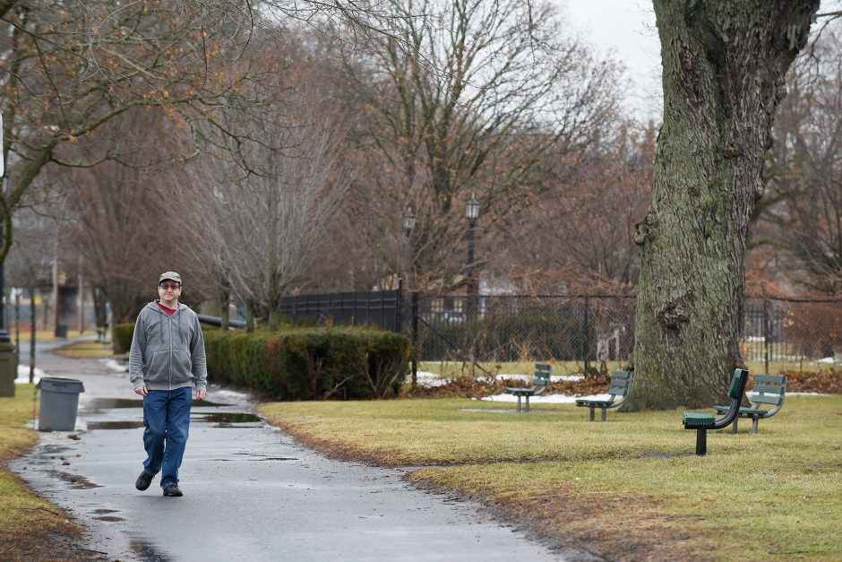 A man takes a walk outside at Riverside Park in the Stockades on Friday afternoon, January 12, 2018.