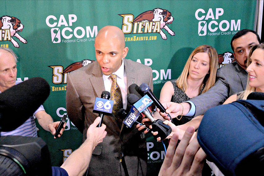 Siena College men's basketball head coach Jamion Christian addresses media members in Albany.
