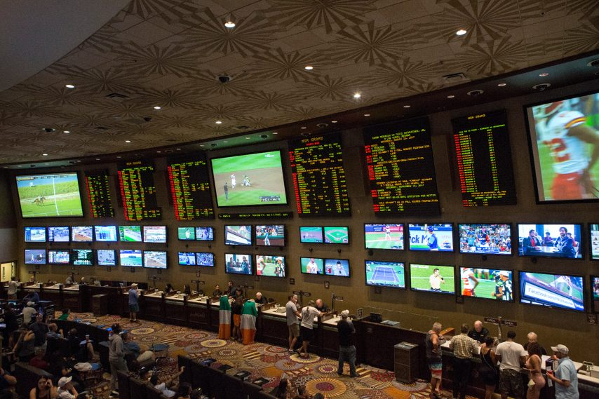 People place bets on sports at the MGM Grand Race & Sports Book in Las Vegas in 2017.