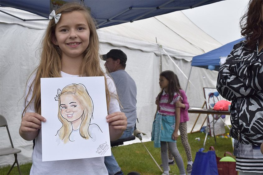 Ashlyn Peterson smiles with her caricature during the 2016 Niska-Day event. This year's event is Saturday.