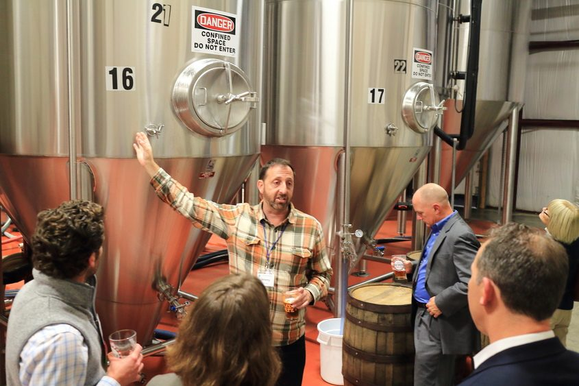 Shmaltz Brewing Company founder and CEO Jeremy Cowan, center, leads a tour of the brewery in Clifton Park in 2017.