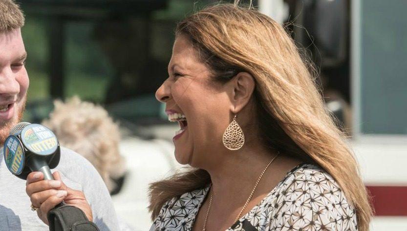New York Lottery's Yolanda Vega presents a prize check in 2017