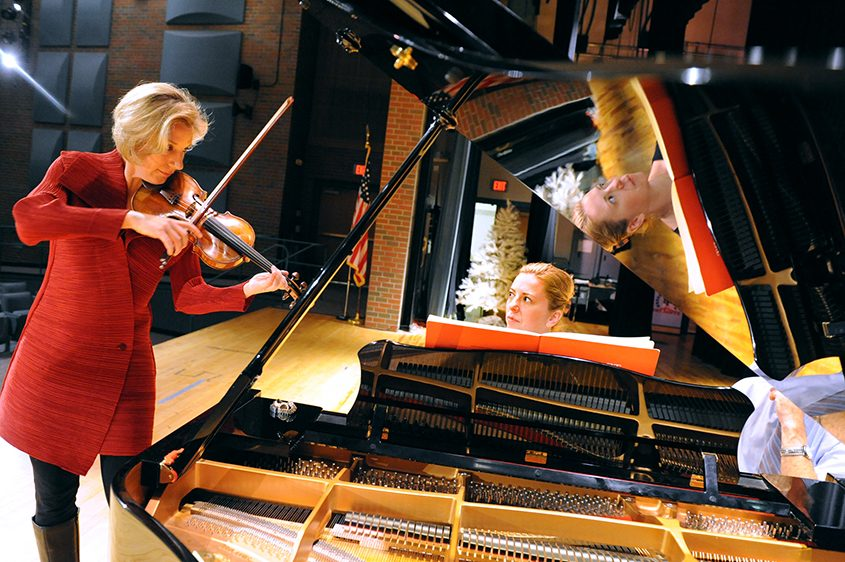 Violinist Elizabeth Pitcairn and pianist Barbara Podgurski rehearse before a past performance at Broadalbin-Perth High School.