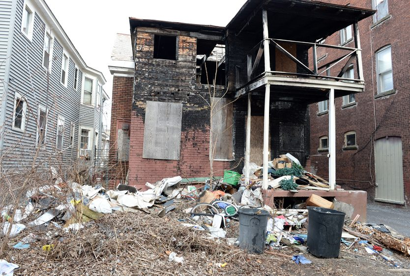 The rear exterior of dilapidated 858 Eastern Ave. in Schenectady is seen in 2016.