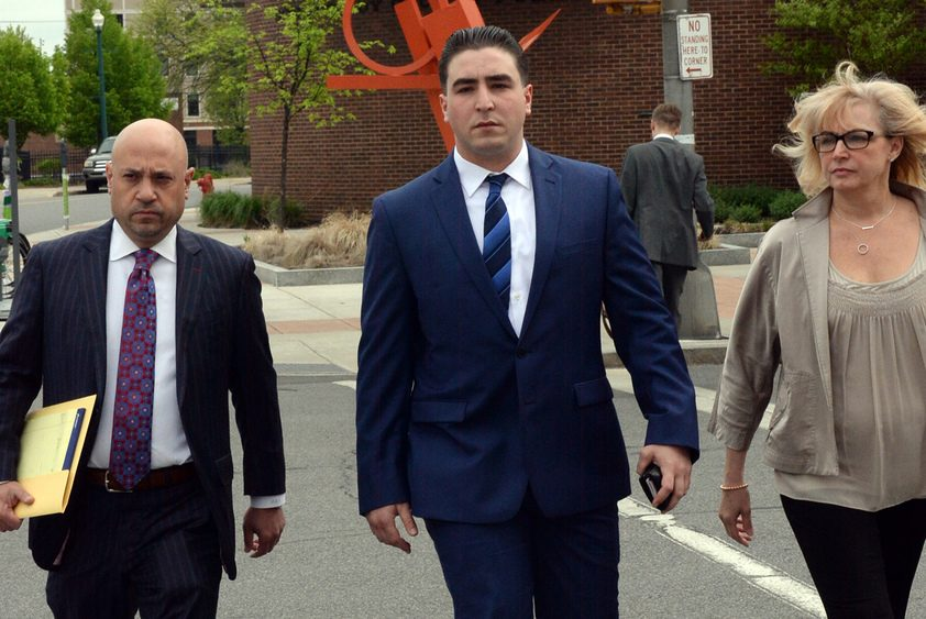 Schenectady police Officer Daniel Coppola head to City Court on May 17.