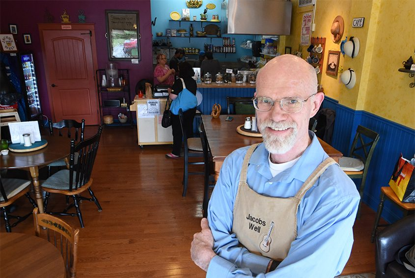 Bellevue Reformed Church pastor Rich Scheenstra stands inside Jacob's Well, a small eatery opened by the church in 2015.