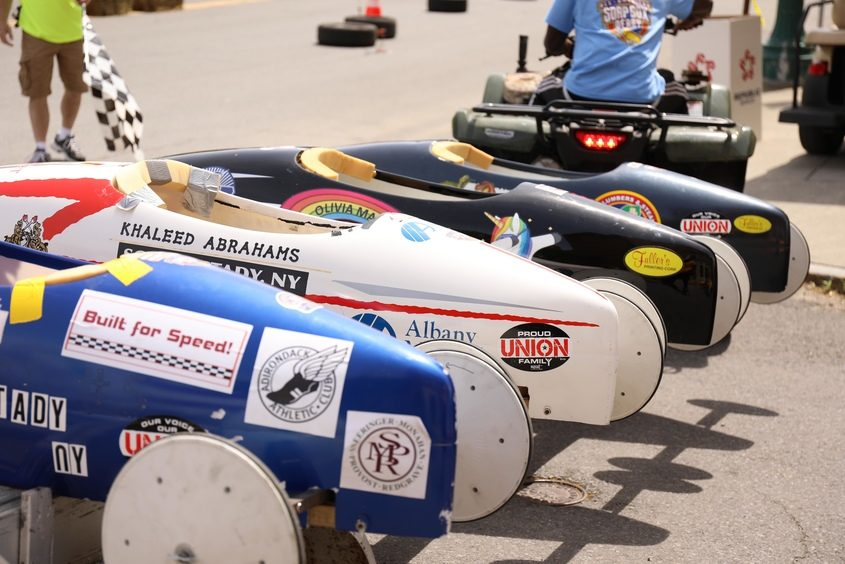 Race entries are seen parked Saturday in the Capital District All-American Soap Box Derby, on Franklin Street in Schenectady.