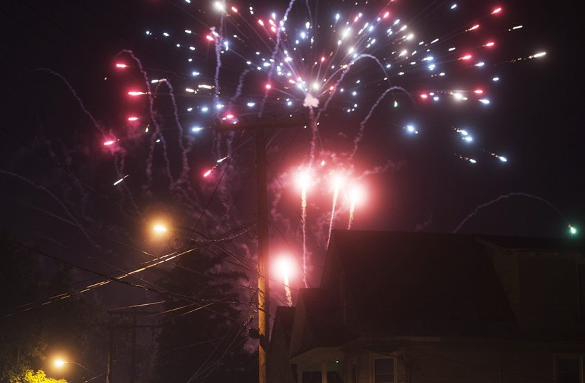 Illegal fireworks tower over roof tops of homes on Schenectady Street on Hamilton Hill on July 4, 2016.