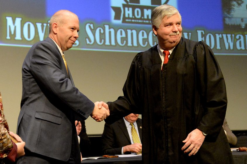 Schenectady City Councilman John Polimeni is given the Oath of Office from Judge Mark Powers.