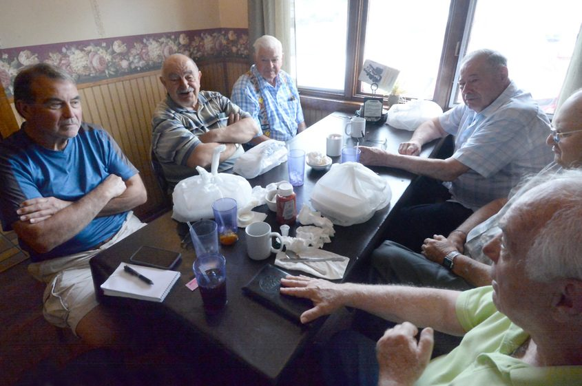 General Electric pensioners discuss GE at lunch at Jonathan's Pizza in Duanesburg on Wednesday.