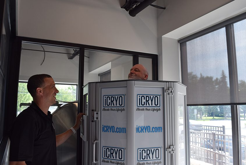 iCryo franchise owner Aric Lemon administers the full body treatment to massage therapist Michael Catellier at iCryo.