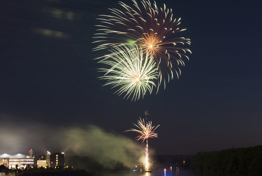 Fireworks illuminate the Mohawk River as they explode overhead from a barge near the Rivers Casino and Resort July 3, 2017.