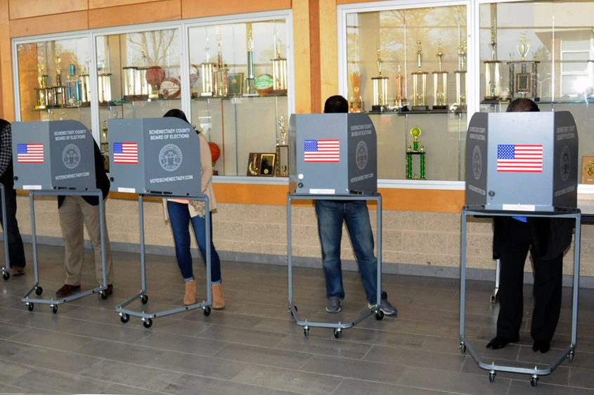 Voters make their choices at Schalmont High School in 2014.