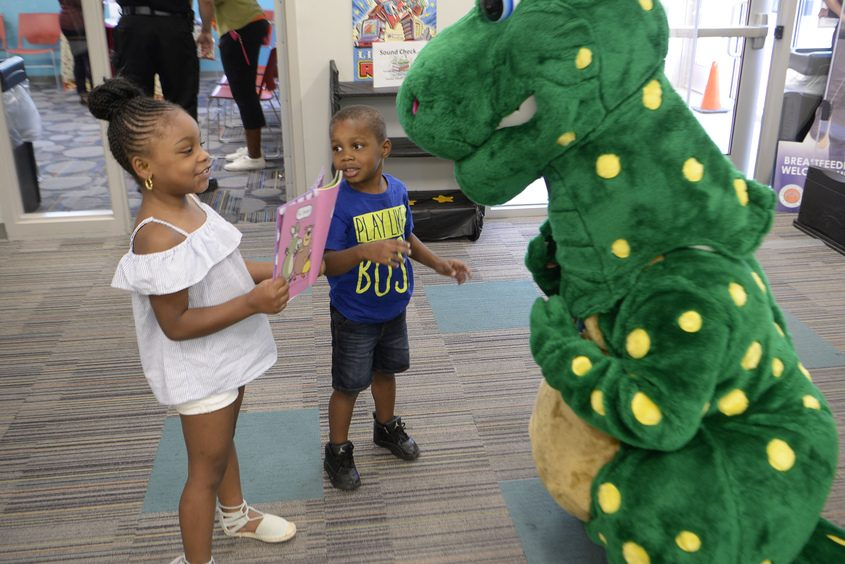 Children interact Tuesday with Fidelisaurus at the Phyllis Bornt Branch Library & Literacy Center on State Street in Schenectady