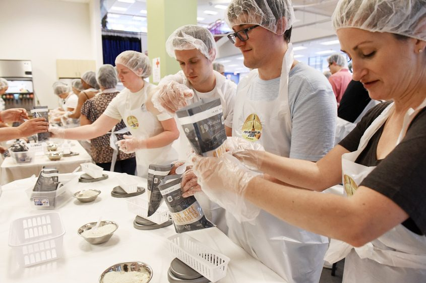 Fingerpaint employees participate in Operation Lunch Lady on Friday to help families facing summer food insecurity.