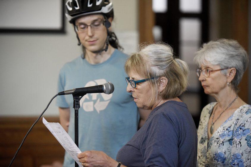 Saratoga Springs resident Joanne Klepetar, with Bikeatoga, speaks during public hearing Monday.