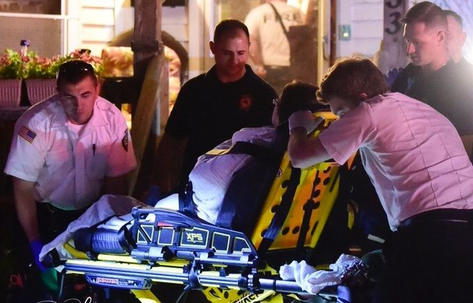 Paramedics tend to a stabbing victim Monday morning on Wing Avenue