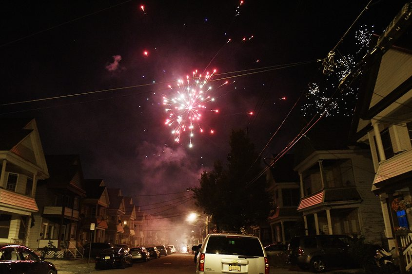 Fireworks light the sky over houses along Stanley Street in Schenectady on July 4.