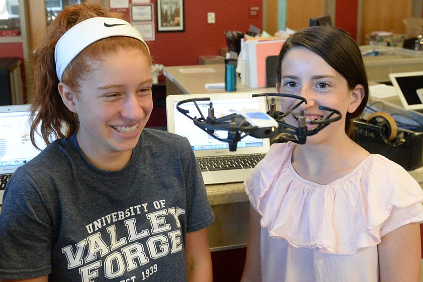 Adelyn Farrell, left, and Sara Mongelli watch their drone at the Engineering Institute for Women at Niskayuna High School.