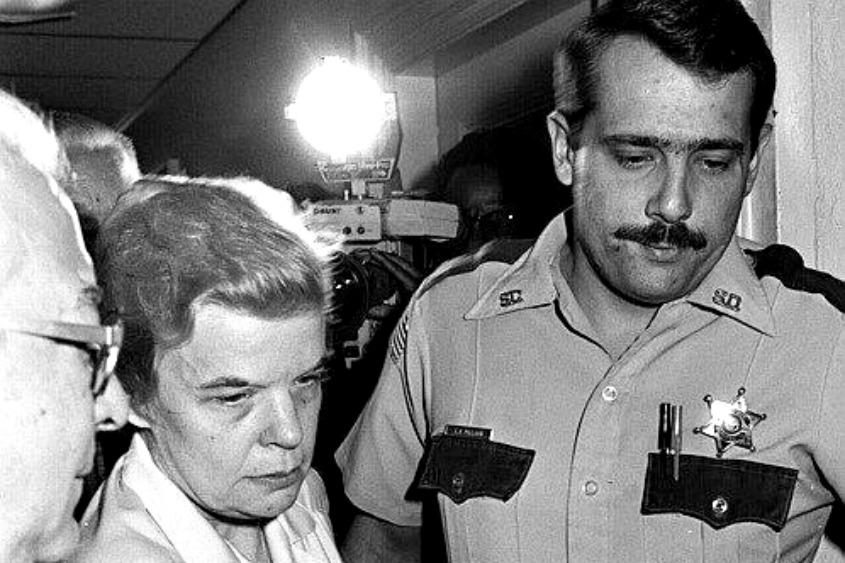 Marybeth Tinning is escorted by police during her trial.