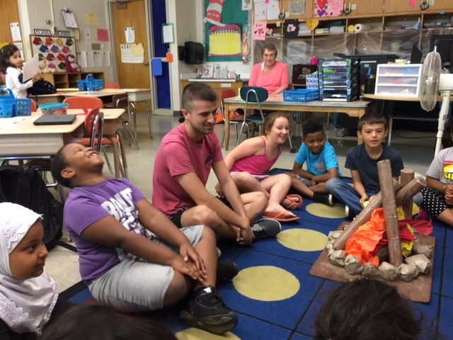Counselor Andrew LeGere works with summer school students in a first grade class at Paige Elementary.