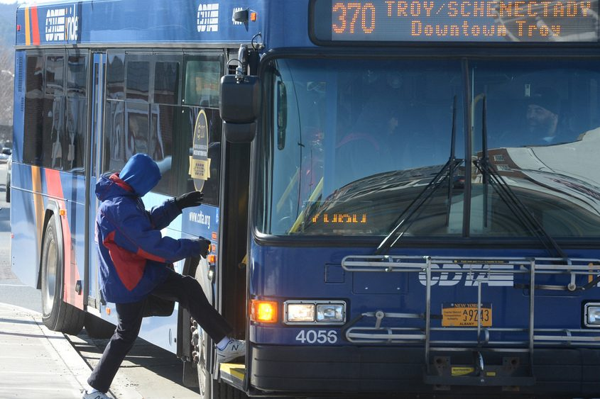 A passenger boards a CDTA bus in downtown Schenectady in March.