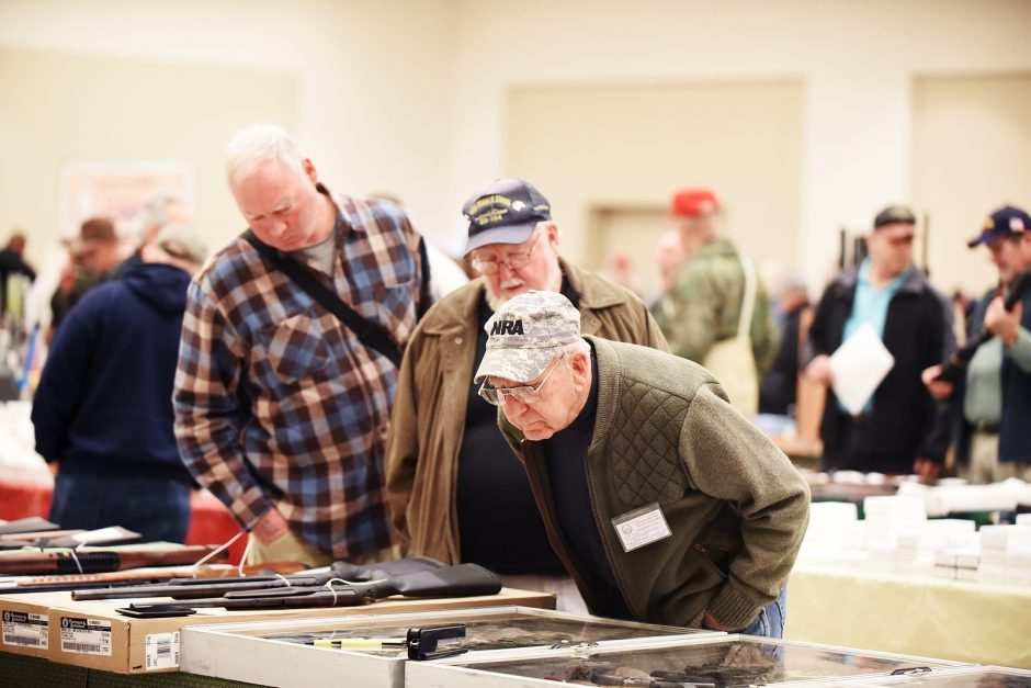 Ken Kennedy looks at pistols during the Gun and Militaria Show at the Saratoga Springs City Center, sponsored by NEACA, in 2016.
