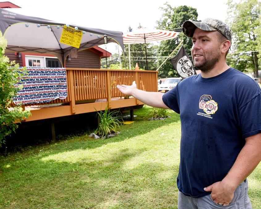 Sean Mulvaney stands on his lawn Saturday where his son Brendan Mulvaney, 7, sold lemonade