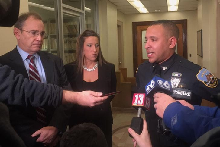 Schenectady Police Officer Mark Weekes, right, speaks to media after a case in 2016