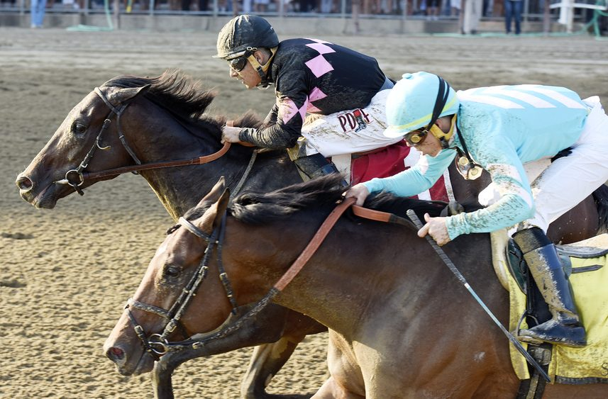 Realm and jockey Junior Alvarado catch Kurilov (Irad Ortiz Jr.) at the wire to win the $100,000 Alydar.