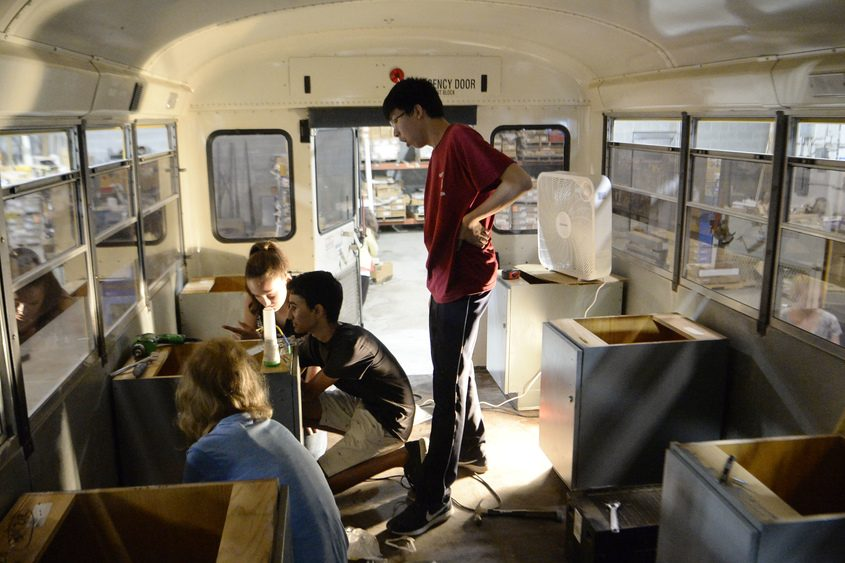 Caleb Tysz, 14, left, Rohan Menon, 15, Haley Neufeld, 15, and Jeffrey Huang, 14, work in the new S.T.E.A.M. Bus