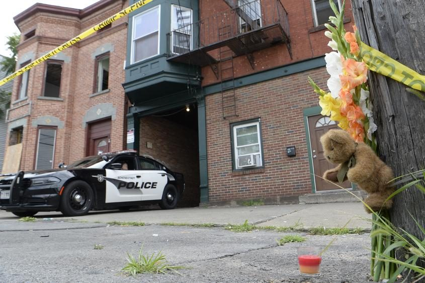 Schenectady Police stand by at 766 State St. where a makeshift memorial has been set up.