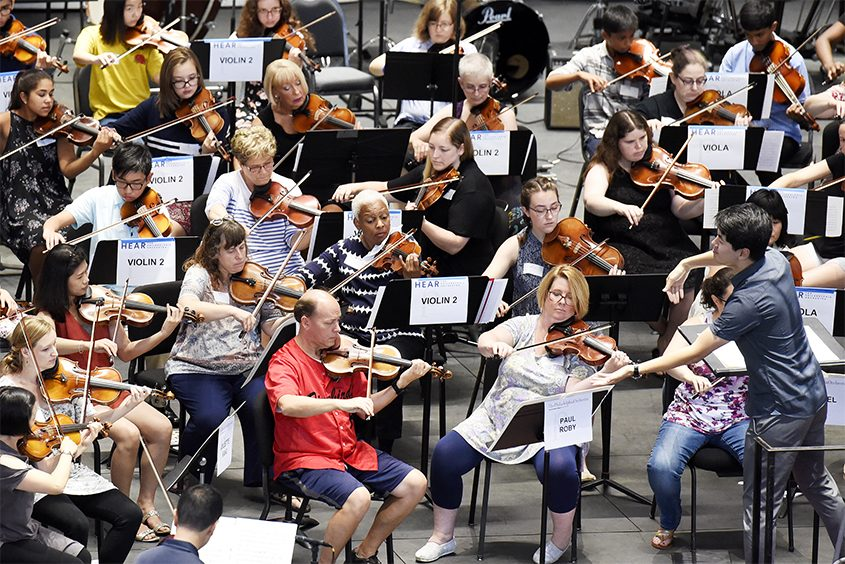Philadelphia Orchestra assistant conductor Kensho Watanabe guides Play-In participants at SPAC Friday.