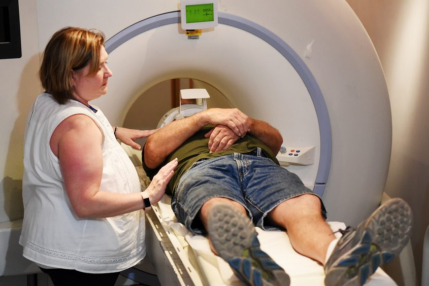 Pete Salmon, of Saratoga, gets ready for a free brain scan in the MRI room with the help of AmyRussell, a radiology supervisor.