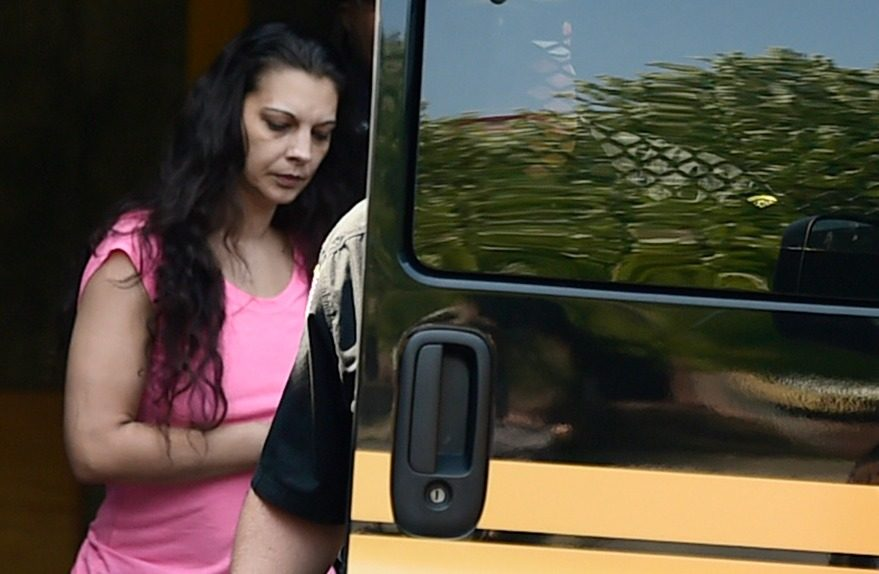Heaven Puleski is brought out of the Schenectady Police Department after court Wednesday
