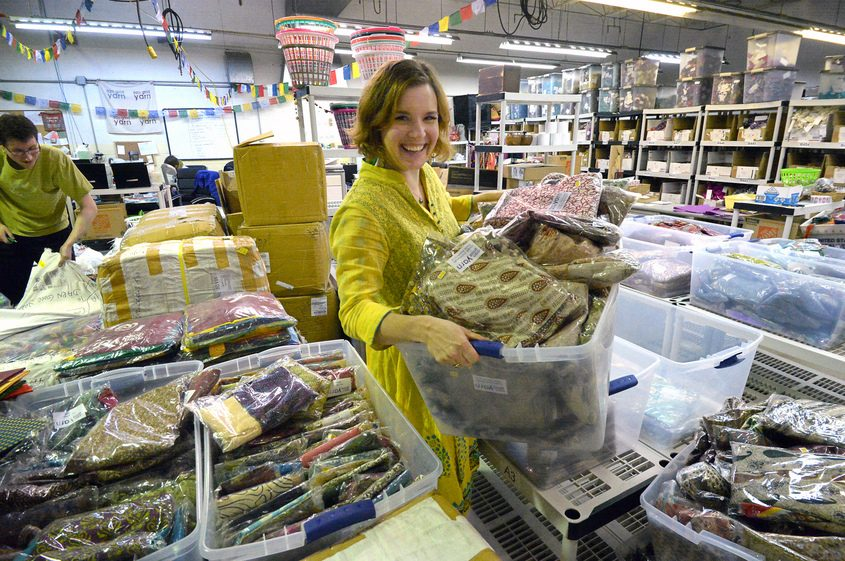Nicole Snow, founder and CEO of Darn Good Yarn, is shown in her warehouse in January.