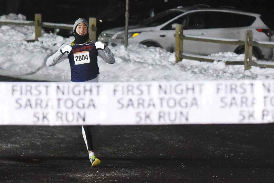 Lukas Motschmann wins the 20th annual First Night Saratoga 5K at Skidmore College in Saratoga Springs December 31, 2017.