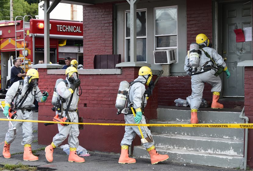 Members of the Schenectady County Hazardous Materials Team enter a rooming house at 354 Edison Ave. Thursday.