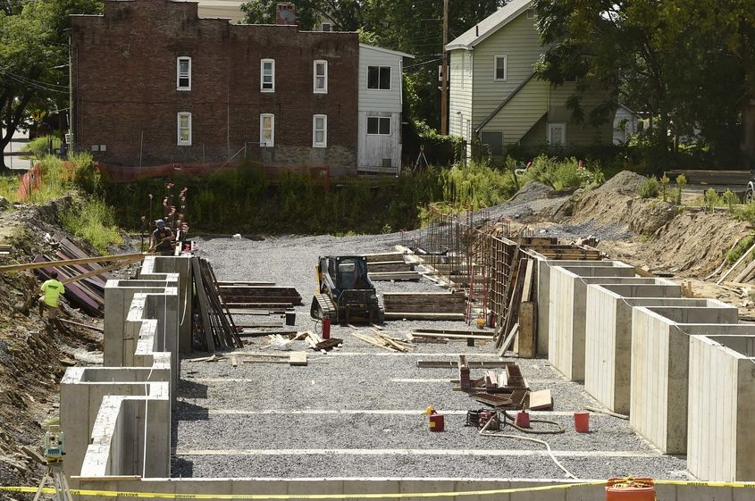 The foundation for new housing on Barrett Street in Schenectady is pictured on Aug. 23.
