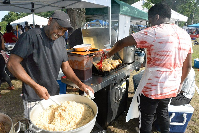 Marvyn Rermaud mixes rice at Sunday's Guyana Day in Grout Park in Schenectady.