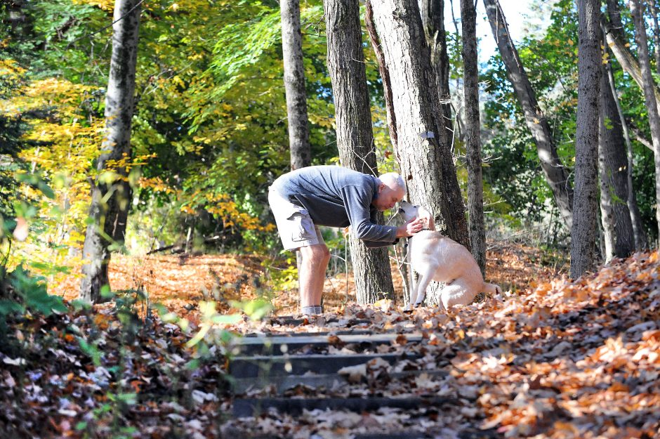 Rick Sleeper of Glenville and his Labrador retriever are pictured in the Indiankill Preserve in Glenville.
