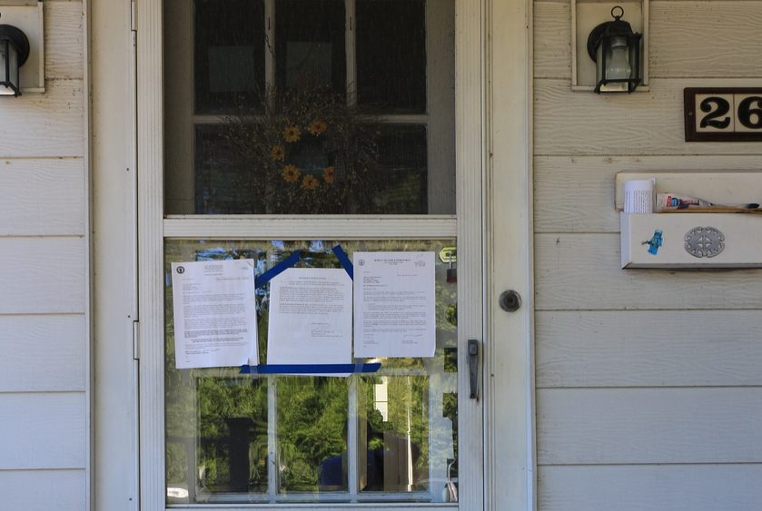 Notices are taped to the front door of a vacant house at 262 Bradley Blvd. in Schenectady.