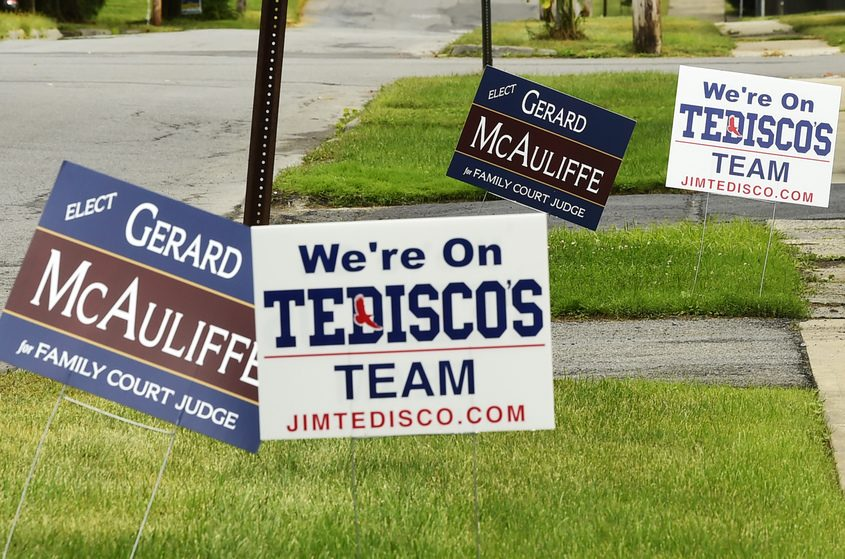 Campaign are posted on South Melcher Street in Johnstown on Tuesday.