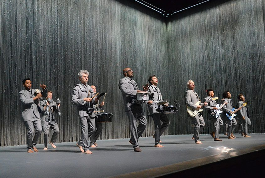 David Byrne (white guitar) and band at the Palace Theatre Sunday night.